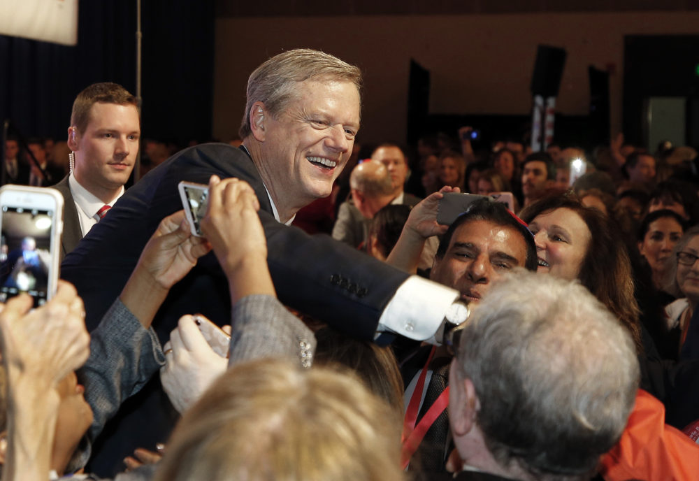 Republican Gov. Charlie Baker greets supporters during an election night rally Tuesday, Nov. 6, 2018, in Boston. (Winslow Townson/AP)