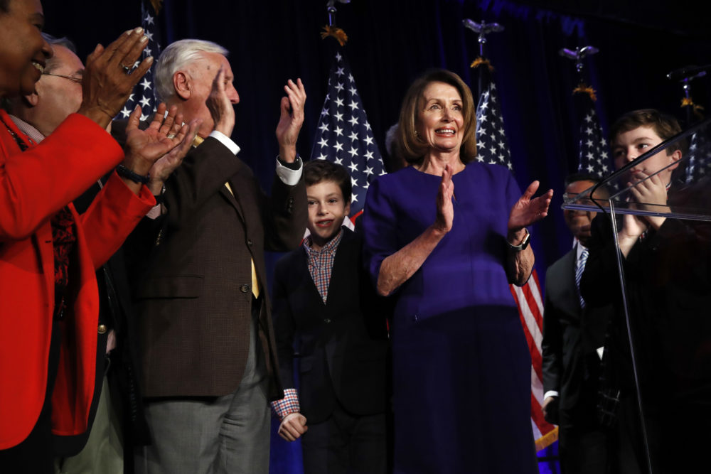 House Democratic Leader Nancy Pelosi of Calif., right, claps between her two grandsons on stage with House Democrats after speaking about Democratic wins in the House of Representatives to a crowd of Democratic supporters during an election night returns event at the Hyatt Regency Hotel, on Tuesday, Nov. 6, 2018, in Washington. (Jacquelyn Martin/AP)