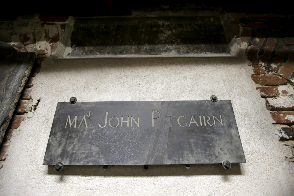 In this Wednesday, Nov. 7, 2018 photo, a plaque marks the tomb of Revolutionary War British Marine Major John Pitcairn in the basement of Old North Church, in Boston. Pitcairn was buried at the church after he was mortally wounded during the 1775 Battle of Bunker Hill. (Steven Senne/AP)