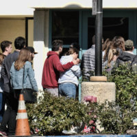 People are led into the Thousand Oaks Teen Center where families have gathered after a deadly shooting at a bar on Thursday, Nov. 8, 2018, in Thousand Oaks, Calif. Multiple people were shot and killed late Wednesday by a gunman who opened fire at the Borderline Bar & Grill, which was holding a weekly country music dance night for college students. (Richard Vogel/AP)