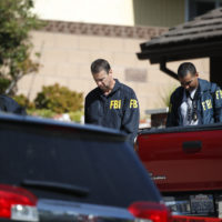 FBI agents leave the house of shooting suspect David Ian Long after conducting a search in Newbury Park, Calif., on Thursday, Nov. 8, 2018. Authorities said the former Marine opened fire at a country music bar in Southern California on Wednesday evening. (Jae C. Hong/AP)