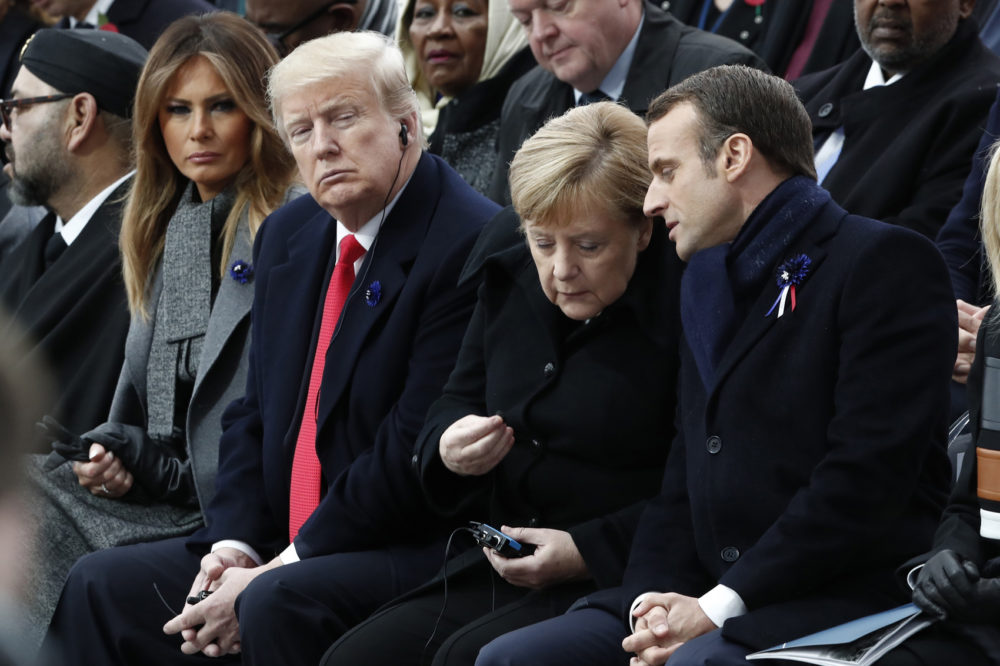 French President Emmanuel Macron, German Chancellor Angela Merkel, U.S. President Donald Trump and first lady Melania Trump attend a commemoration ceremony for Armistice Day, 100 years after the end of the First World War at the Arc de Triomphe in Paris, France, Sunday, November 11, 2018. (Benoit Tessier/Pool Photo via AP)