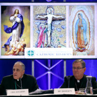 Cardinal Daniel DiNardo of the Archdiocese of Galveston-Houston, left, president of the United States Conference of Catholic Bishops, speaks alongside Bishop Timothy Doherty of the Diocese of Lafayette-in-Indiana at a news conference during the USCCB's annual fall meeting, Monday, Nov. 12, 2018, in Baltimore. (Patrick Semansky/AP)