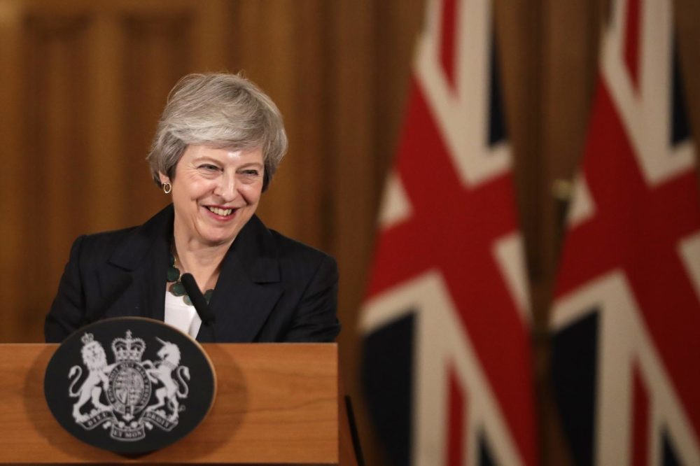 "Britain's Prime Minister Theresa May smiles during a press conference inside 10 Downing Street in London, Thursday, Nov. 15, 2018. British Prime Minister Theresa May says if politicians reject her Brexit deal, it will set the country on ""a path of deep and grave uncertainty."" Defiant in the face of mounting criticism, May said Thursday she believed ""with every fiber of my being"" that the deal her government struck with the European Union was the right one. (Matt Dunham, Pool/AP)"