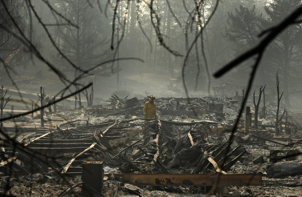 A firefighter searches for human remains in a trailer park destroyed in the Camp Fire, Friday, Nov. 16, 2018, in Paradise, Calif. (John Locher/AP)