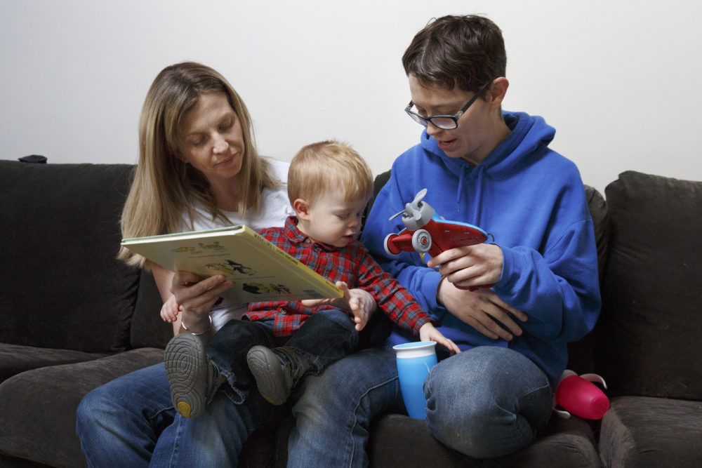 Anna Ford, left, and her partner, Sara Watson, play with their son Eli at home in the village of Saunderstown, in Narragansett, R.I. Three years after the landmark U.S. Supreme Court case that gave same-sex couples the right to marry nationwide, a patchwork of outdated state laws governing who can be a legal parent presents obstacles for many LGBTQ couples who start a family, lawyers say. (Michael Dwyer/AP)