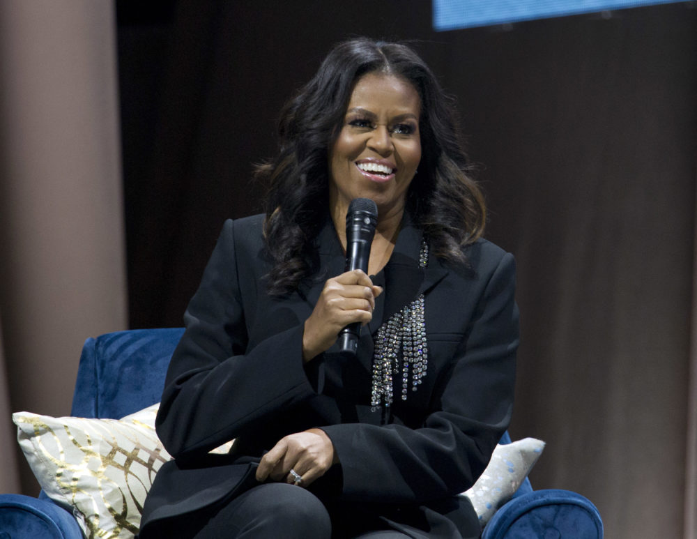 "Former first lady Michelle Obama speaks to the crowd as she presents her anticipated memoir ""Becoming"" during her book tour stop in Washington, Saturday, Nov. 17, 2018. (Jose Luis Magana/AP)"