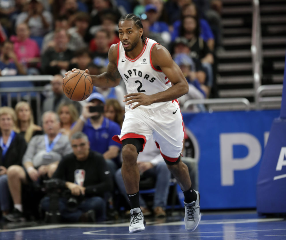 b417978376f Toronto Raptors  Kawhi Leonard moves the ball against the Orlando Magic  during a game on