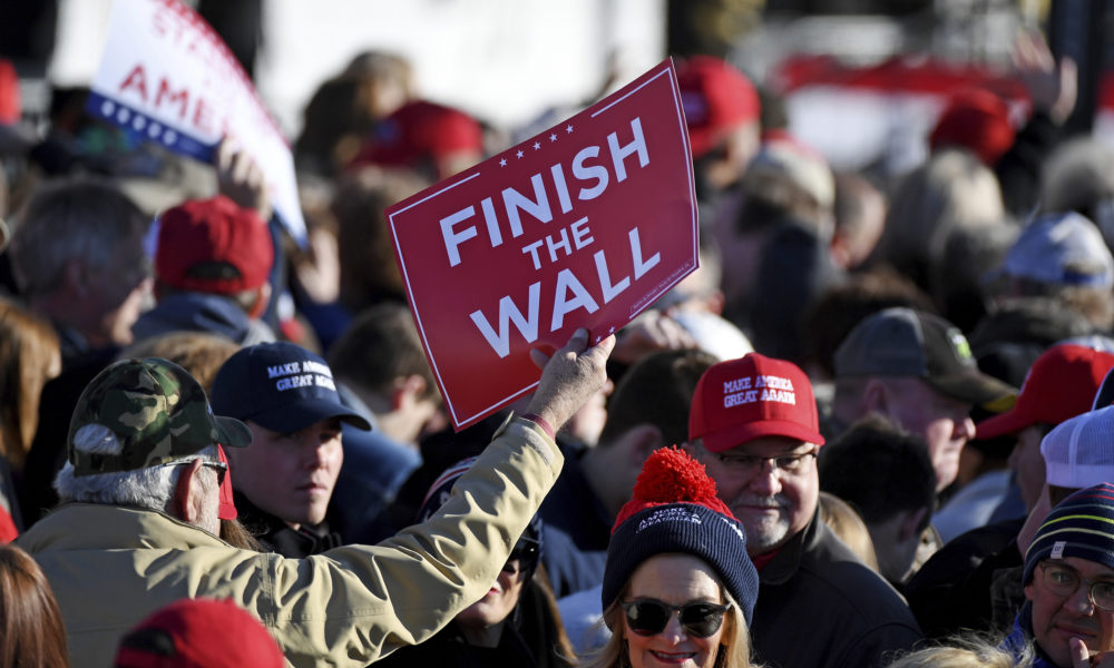 Supporters hold up signs before a rally with President Donald Trump in Tupelo, Miss., Monday, Nov. 26, 2018. (Thomas Graning/AP)