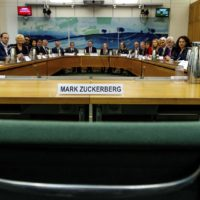 "The International Grand Committee with representation from 9 Parliaments and Mark Zuckerberg in non-attendance. Lawmakers from nine countries grilled Facebook executive, Richard Allan, on Tuesday as part of an international hearing at Britain's parliament on disinformation and ""fake news."" Facebook's vice president for policy solutions, answered questions in place of his boss, CEO Mark Zuckerberg, who ignored repeated requests to appear. (Gabriel Sainhas/House of Commons via AP)"