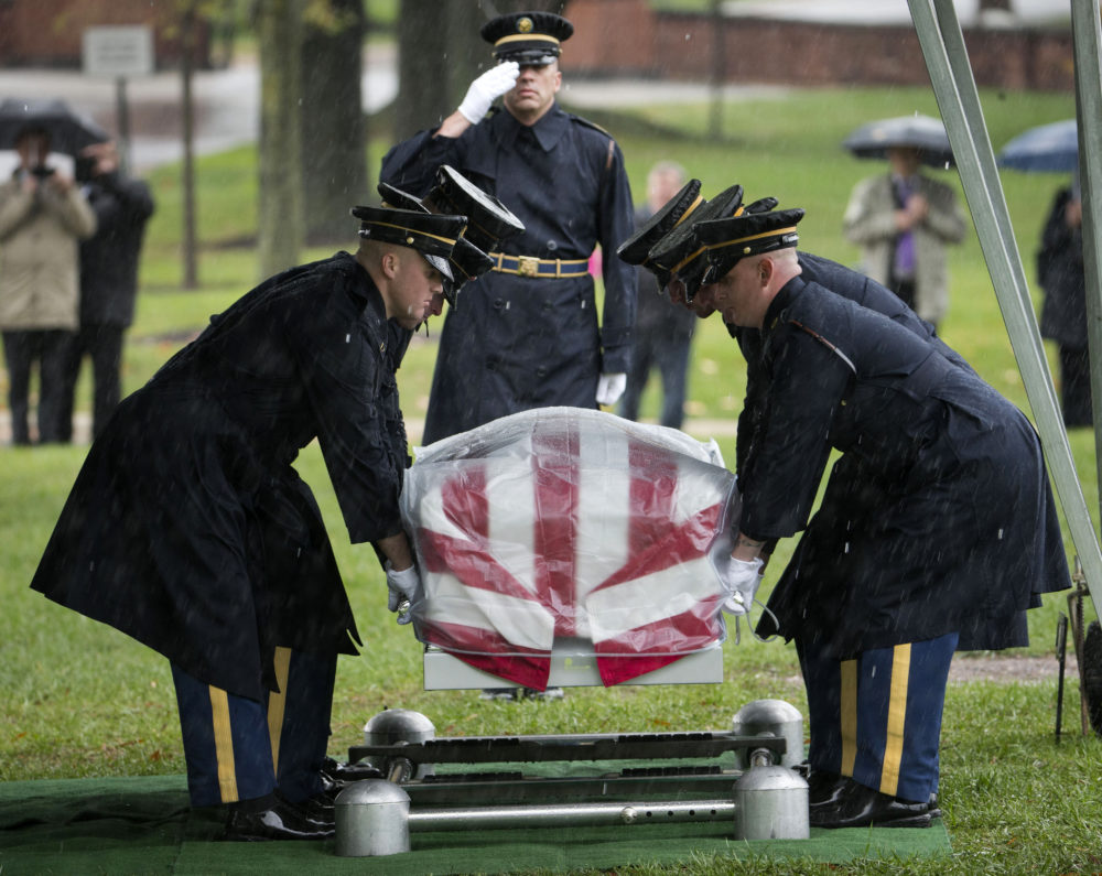 Members of the Army's 3rd US Infantry Regiment (The Old Guard) lower the coffin containing the remains of WWII Army Pfc. Cecil E. Harris, during burial services at Arlington National Cemetery in Arlington, Va., Wednesday, Oct. 22, 2014. According to the Defense Department, Harris, of Tennessee, was assigned to Army's 179th Infantry Regiment, 45th Infantry Division, when his rifle platoon came under heavy fire from German troops on Jan. 2, 1945 in Dambach, France. (AP Photo/Pablo Martinez Monsivais)