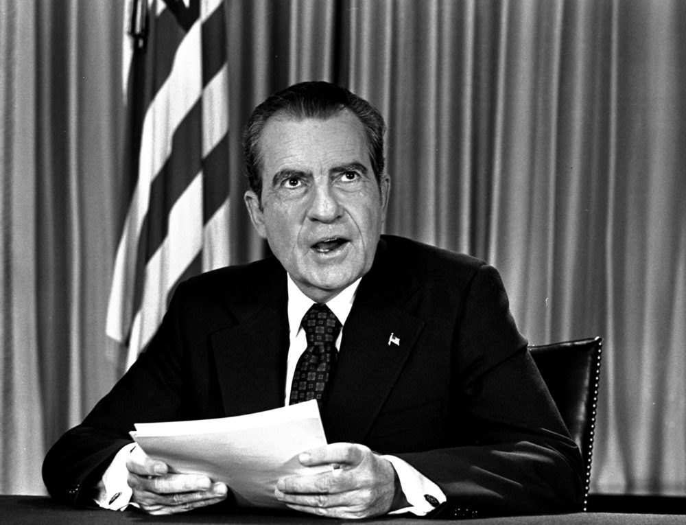President Nixon sits in his White House office, Aug. 16, 1973, as he poses for pictures after delivering a nationwide television address dealing with Watergate. (AP Photo)