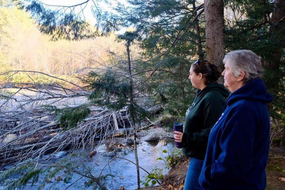 Chelsie Lent and Carole Clarke are co-owners of Scenic View Campground in Warren, NH. The Baker River, which runs along the back of their property, has flooded multiple times in recent years. (Britta Greene/New Hampshire Public Radio)