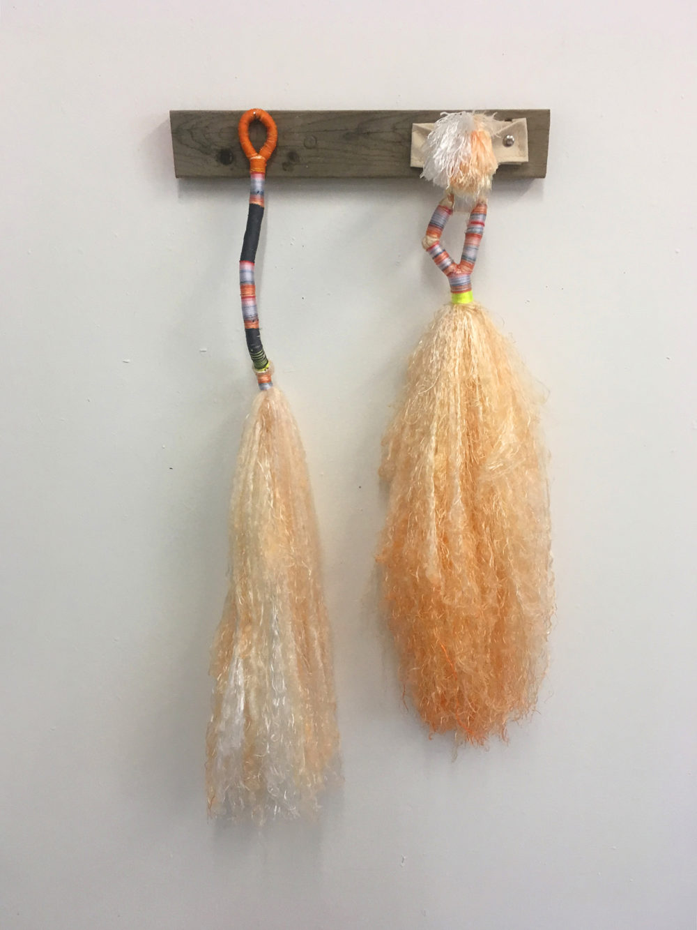 "Daniel Zeese's ""Two Orange Brooms."" (Courtesy of the artist)"