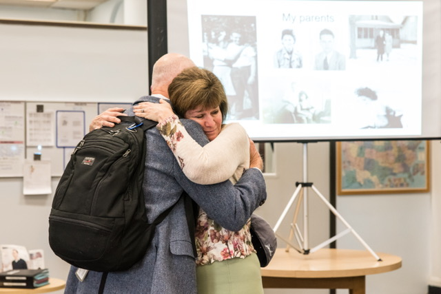 Debbie Long hugs Bruce Carnes, whose father rescued her mother from a concentration camp in World War II. (Maia Kennedy Photography)