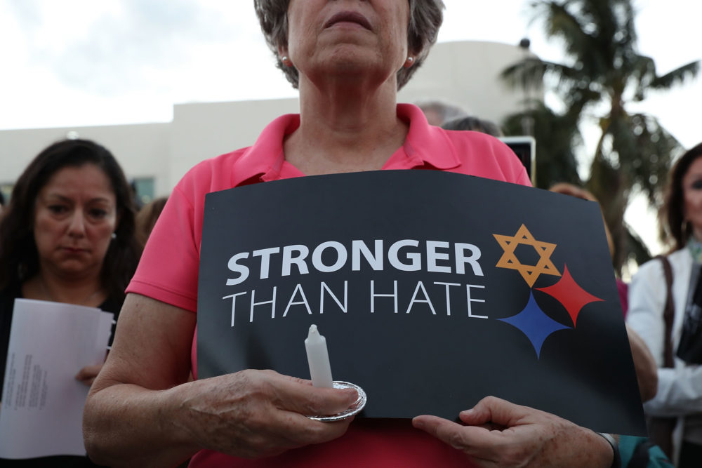 A person holds a sign that reads, 'Stronger than Hate,'  during a vigil at the Holocaust Memorial Miami Beach to remember the victims of a mass shooting at a synagogue in Pittsburgh. (Joe Raedle/Getty Images)