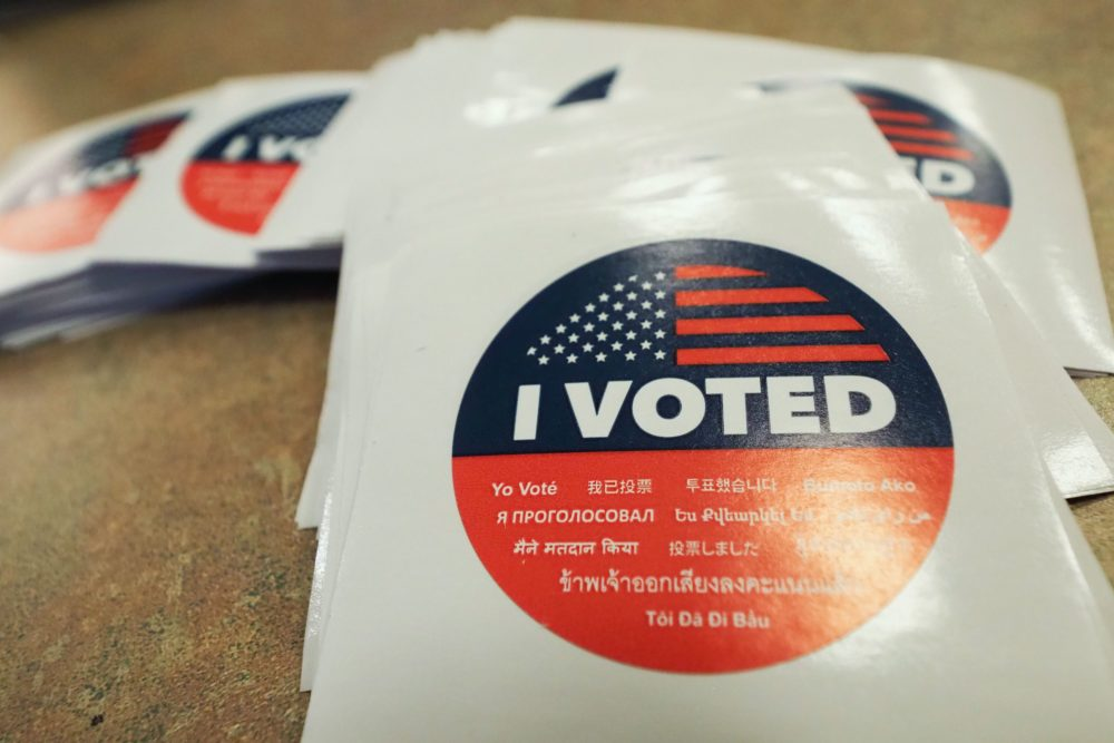 """An """"I Voted"""" sticker is seen at polling station during early voting for the mid-term elections in the Lakeview Terrace neighborhood of Los Angeles, California on November 4, 2018. (Robyn Beck/AFP/Getty Images)"""