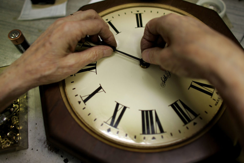 Howard Brown repairs a clock at Brown's Old Time Clock Shop in Plantation, Florida. (Joe Raedle/Getty Images)