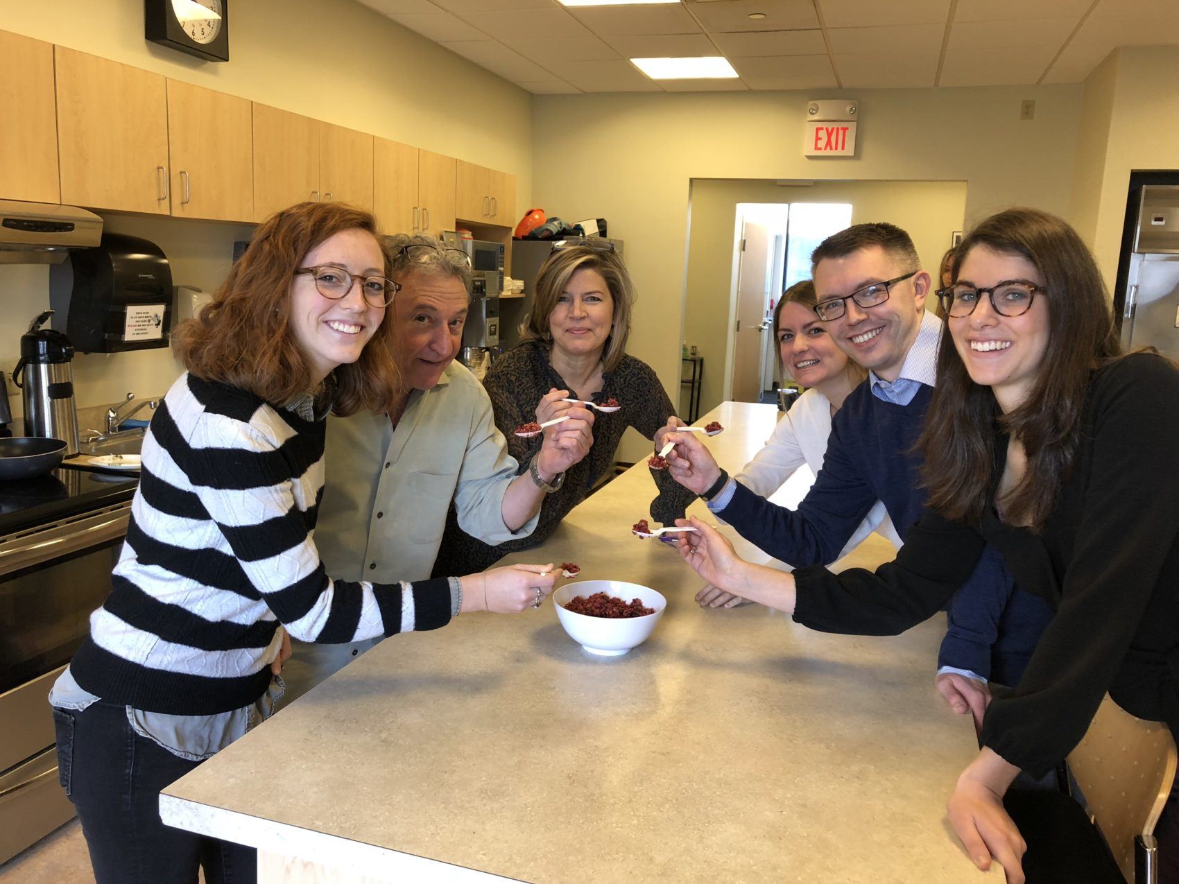 The On Point team enjoys some cranberry-pomegranate relish made by producer Stef Kotsonis (second from left). (Alex Schroeder/On Point)