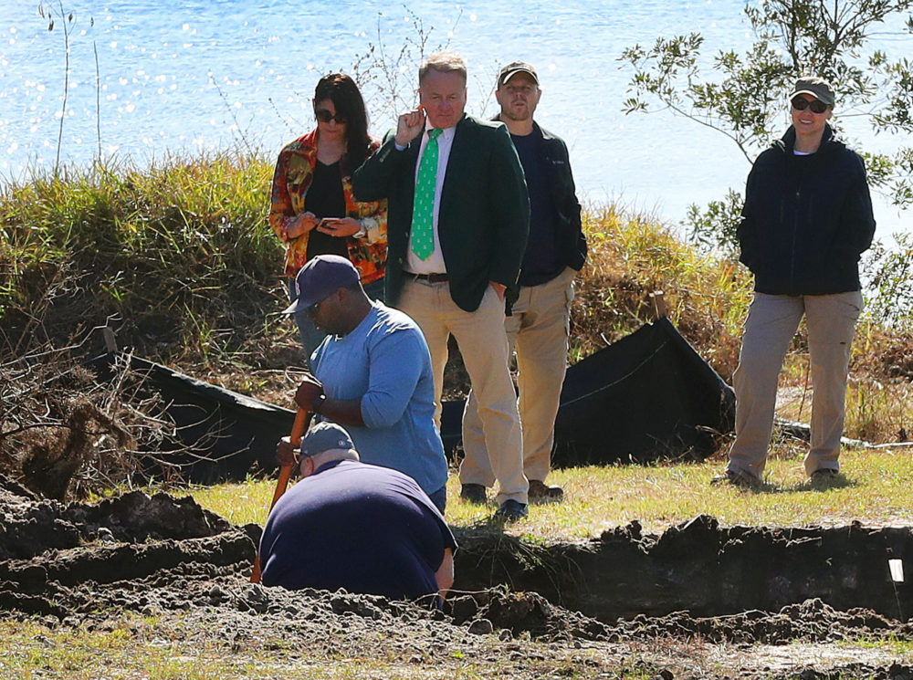 John Bill, in a green tie, watches as the FBI and other investigators observe the excavation of a lot in Florida in hopes of finding the stolen Isabella Stewart Gardner Museum artwork on Jan. 31, 2018. (John Tlumacki/Globe Staff)