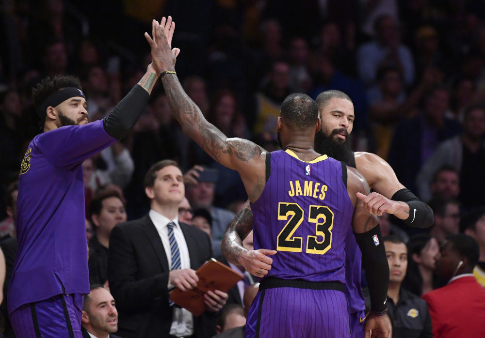 Los Angeles Lakers forward LeBron James is congratulated by teammates after he passed Wilt Chamberlain for fifth place in career points on Wednesday. (AP/Mark J. Terrill)