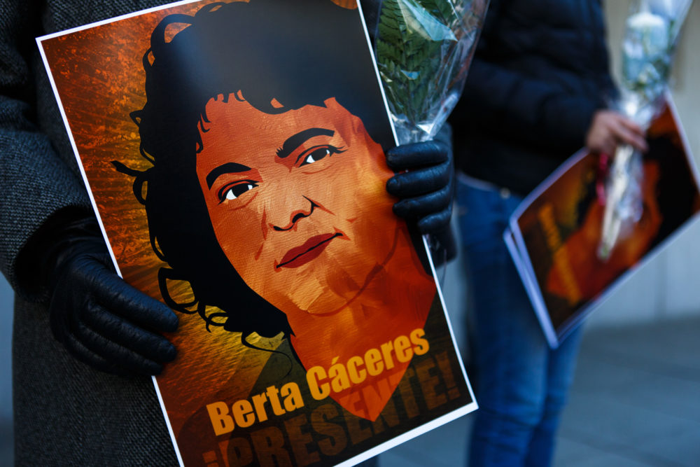 Demonstrators hold a portrait of human rights and land rights defender Berta Cáceres, of Honduras, at a vigil in Washington, D.C. on April 5, 2016. (Keith Lane/Oxfam America)