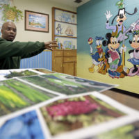 Valentino Dixon, in his prison cell, talks about the golf art he created. (David Duprey/AP)