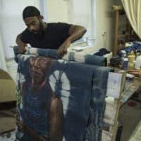 Artist Stephen Hamilton works in his studio (Alberto Montalvo for WBUR)