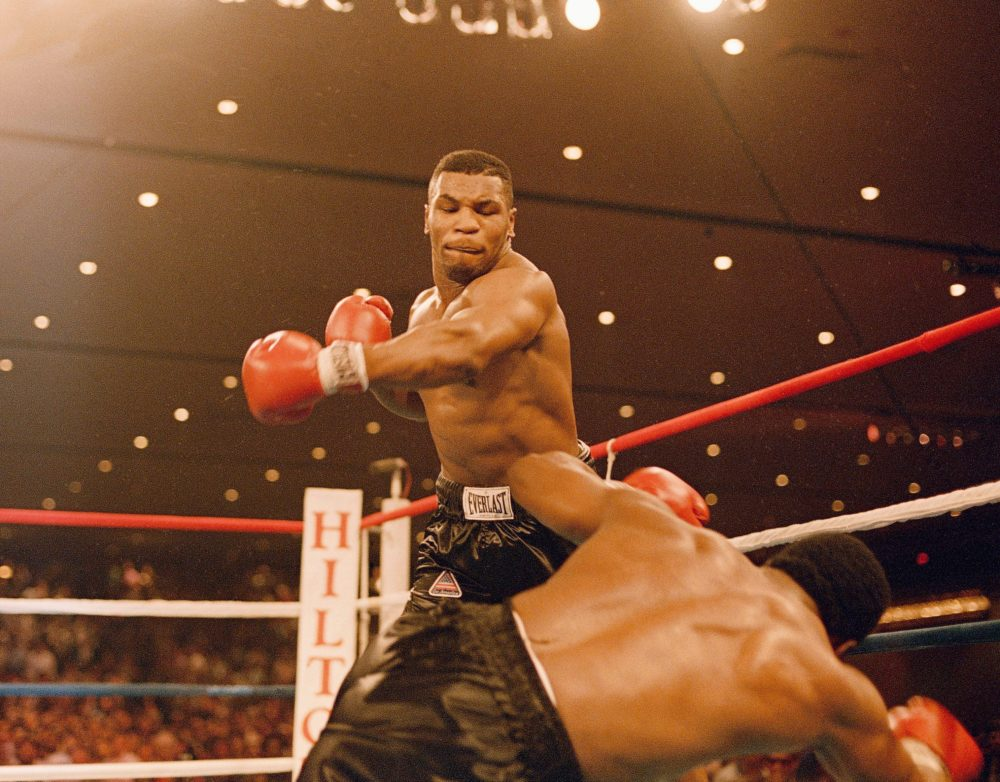 Mike Tyson knocks down Trevor Berbick on Nov. 22, 1986. It took Tyson two rounds to become, at age 20, the youngest heavyweight champion ever. (AP)