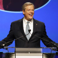 Republican Gov. Charlie Baker acknowledges applause from supporters during an election night rally Tuesday in Boston. (Winslow Townson/AP)