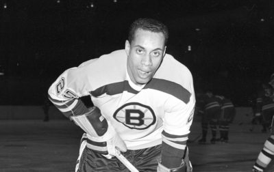 In this Nov. 23, 1960, file photo, 25-year-old left wing Willie O'Ree, the first black player of the National Hockey League, poses for a photo as he warms up in his Boston Bruins uniform prior to an NHL game with the New York Rangers at New York's Madison Square Garden. O'Ree was selected to the Hockey Hall of Fame on June 26, 2018. (AP)