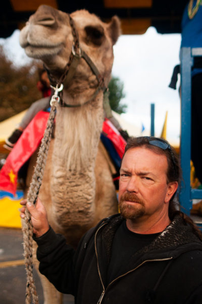 Tim Commerford with one of his camels at the Big E in October. (Ben James/NEPR)