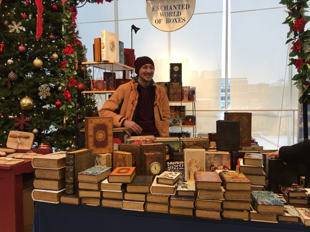A table selling Enchanted World of Boxes at a previous Harvard Square Holiday Market. (Courtesy)