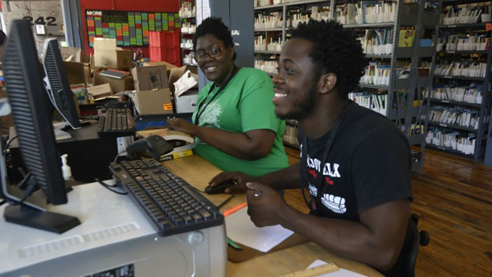 Shanaya King, left, works alongside a fellow More Than Words employee. (Courtesy of More Than Words)