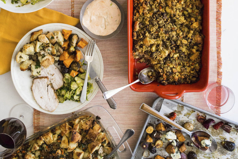 This October 2017 photo provided by Katie Workman shows food on the table at her apartment in New York. When you are making a big Thanksgiving dinner getting as much done ahead of time - and enlisting as much help from family and friends as possible — makes these epic meals much more enjoyable. (Sarah Crowder/Katie Workman via AP)
