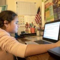 Eve, 13, studies on her computer. (Robin Lubbock/WBUR)