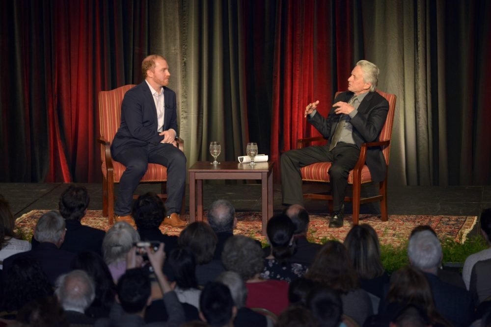 Michael Douglas talks with Here & Now's Jeremy Hobson at Boston University's Howard Gotlieb Archival Research Center. (Courtesy of Allan Dines Photography/Boston University)