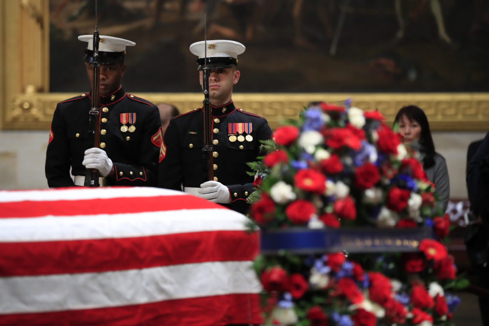 U.S. Marine Corps honor guard execute a rifle salute during the changing of the guard at the Capitol Rotunda where former President George H.W. Bush lies in state Wednesday. (Manuel Balce Ceneta/AP)