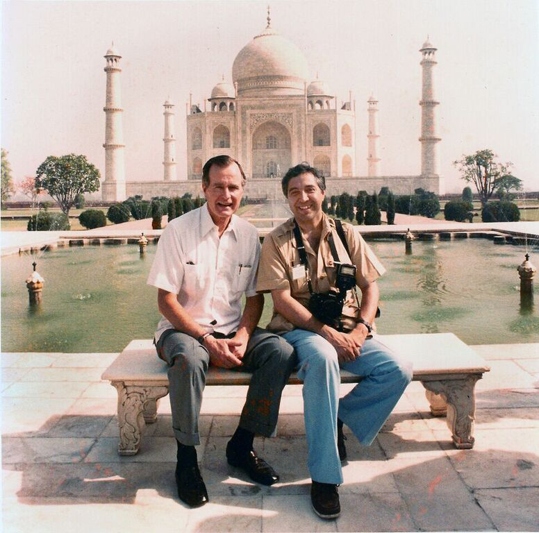 George H.W. Bush poses with White House photographer David Valdez in front of the Taj Mahal. (Courtesy of David Valdez)