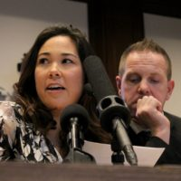 Michelle Harvey tearfully recounted her toddler's fight with cancer, which came at the same time her husband Brian, right, was locked out of his job at National Grid. (Sam Doran/State House News Service.)
