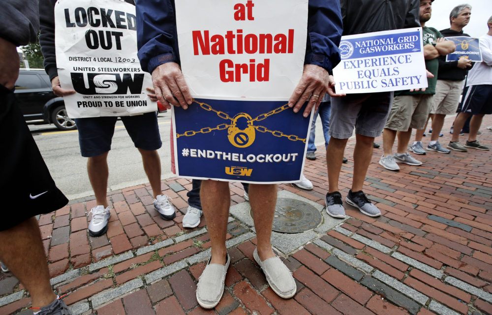 Gas workers picket on the steps of the Statehouse in Boston, Wednesday, Sept. 19, 2018. The union representing natural gas workers for National Grid says the company has locked out more than 1,000 employees in dozens of Massachusetts communities since June. (Charles Krupa/AP)