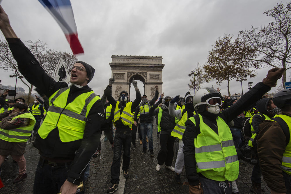 "Protesters yell during a ""yellow vest"" demonstration near the Arc de Triomphe on Dec. 1, 2018 in Paris. (Veronique de Viguerie/Getty Images)"
