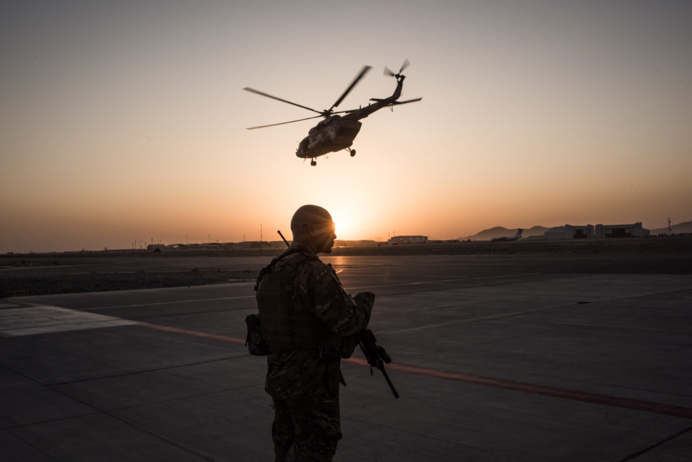 A member of the United States Air Force keeps watch over the runway on Sept. 9, 2017 at Kandahar Air Field in Kandahar, Afghanistan. (Andrew Renneisen/Getty Images)