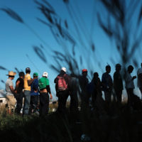 Members of a Central American migrant caravan wait in line for food and other items while in a camp on Oct. 31, 2018 in Juchitan, de Zaragoza, Mexico. (Spencer Platt/Getty Images)
