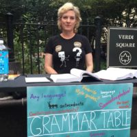 Every week, Ellen Jovin sets up a table in the middle of Manhattan, dissecting grammar for people on the streets. (Courtesy of Ellen Jovin)