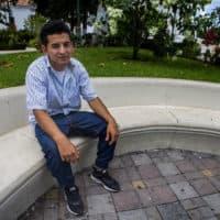 Orlando sits in a plaza in Metapán, El Salvador. (Jesse Costa/WBUR)