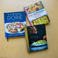 "Three of chef Kathy Gunst's favorite cookbooks of 2018: ""Pie Squared: Irresistibly Easy Sweet & Savory Slab Pies,"" by Cathy Barrow; ""Everyday Dorie: The Way I Cook,"" by Dorie Greenspan; ""Season: Big Flavors, Beautiful Food,"" by Nik Sharma. (Jesse Costa/WBUR)"