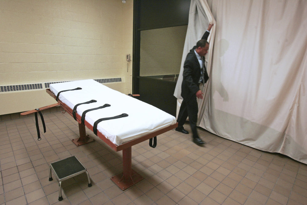 In this November 2005 file photo, Larry Greene, public information director of the Southern Ohio Correctional Facility, demonstrates how a curtain is pulled between the death chamber and witness room at the prison in Lucasville, Ohio. (Kiichiro Sato/AP)