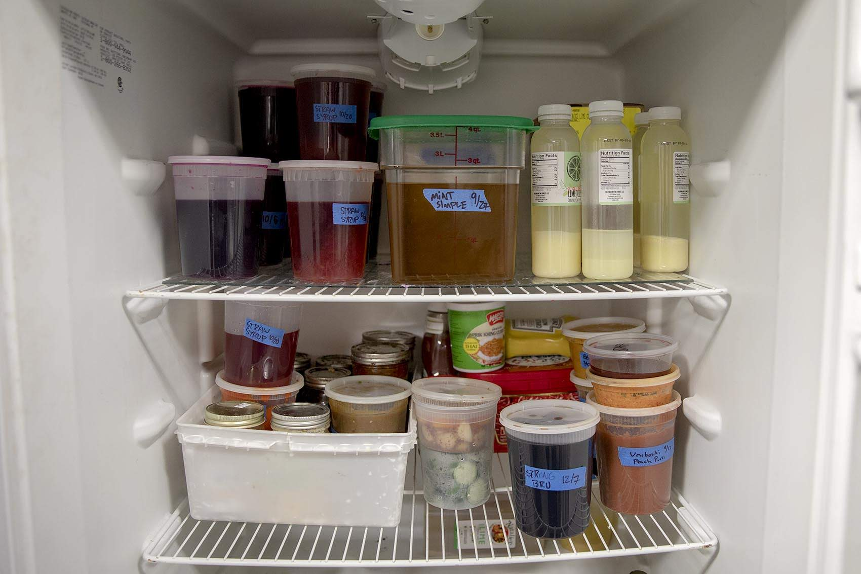 A neatly ordered fridge, with labels on items at Mei Mei in Boston. (Robin Lubbock/WBUR)
