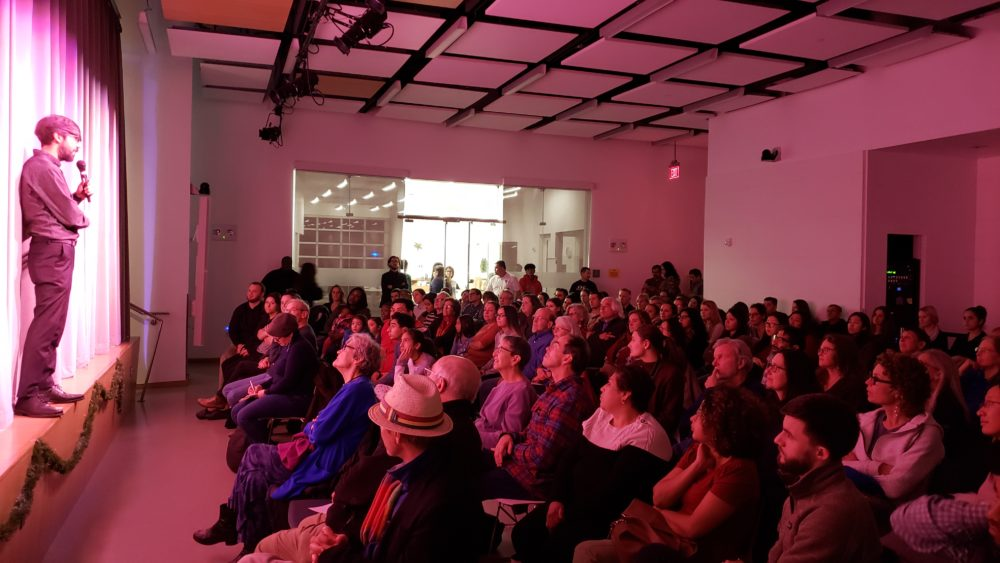 Vahdat Yeganeh, artistic director of Boston Experimental Theatre, addressing the audience at last Friday's performance. (Courtesy Marion Davis)